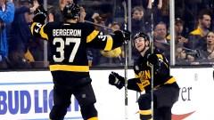 Boston Bruins Center Patrice Bergeron And Defenseman Brandon Carlo