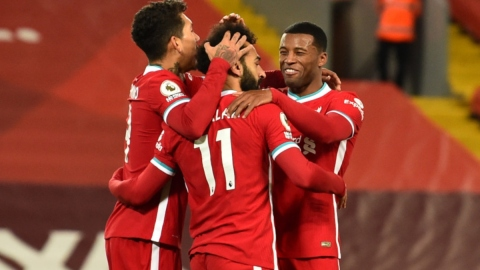 Liverpool midfielder Georginio Wijnaldum (right) and forwards Mohamed Salah (center) and Roberto Firmino (left)