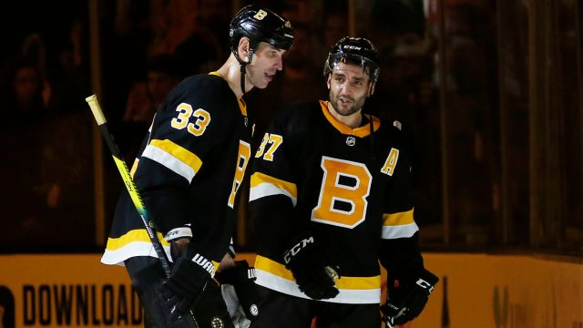 Washington Capitals defenseman Zdeno Chara And Boston Bruins center Patrice Bergeron