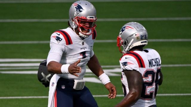 New England Patriots quarterback Cam Newton (1) and running back Sony Michel