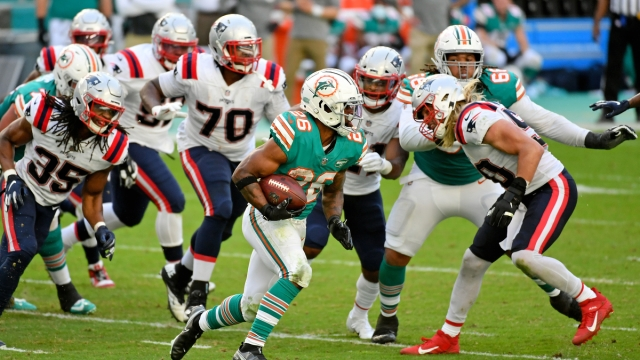 New England Patriots defensive end Chase Winovich, Miami Dolphins running back Salvon Ahmed