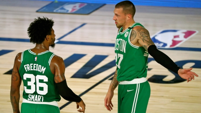 Boston Celtics center Daniel Theis, guard Marcus Smart
