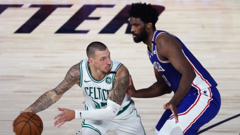 Boston Celtics center Daniel Thies, Philadelphia 76ers center Joel Embiid