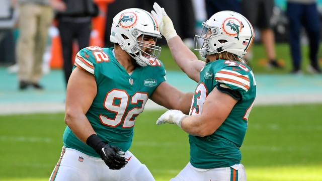 Miami Dolphins defensive end Zach Sieler, Andrew Van Ginkel