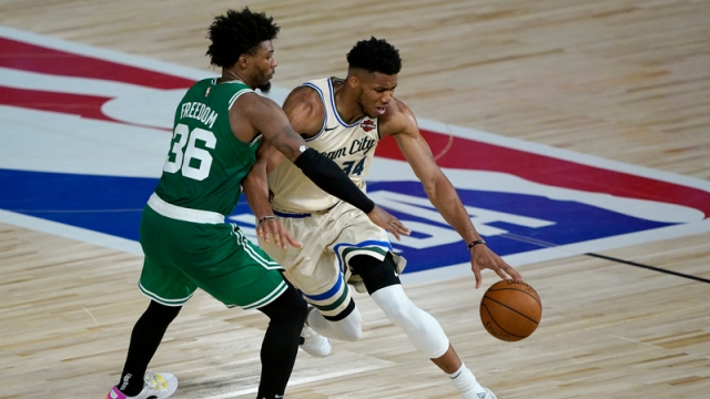 Milwaukee Bucks forward Giannis Antetokounmpo, Boston Celtics guard Marcus Smart