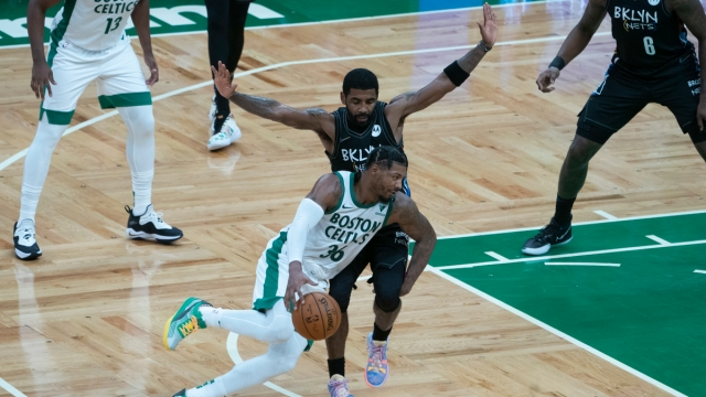 Boston Celtics point guard Marcus Smart, Brooklyn Nets point guard Kyrie Irving