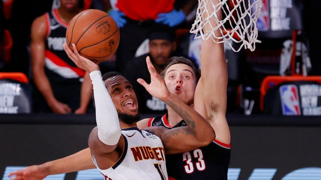 Denver Nuggets point guard Monte Morris and Portland Trail Blazers forward Zach Collins