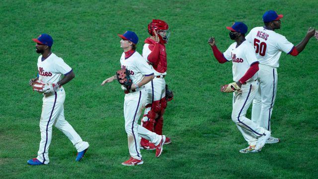 Philadelphia Phillies catcher Rafael Marchan and center fielder Roman Quinn