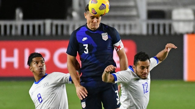 United States and New York Red Bulls defender Aaron Long (center)