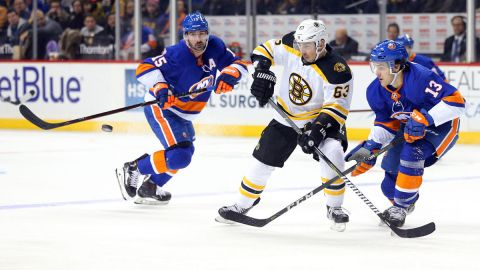 Boston Bruins wing Brad Marchand and New York Islanders center Mathew Barzal