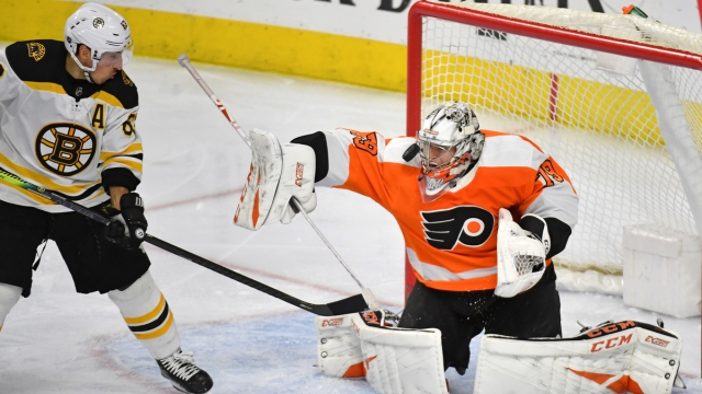 Boston Bruins forward Brad Marchand, Philadelphia Flyers goalie Carter Hart