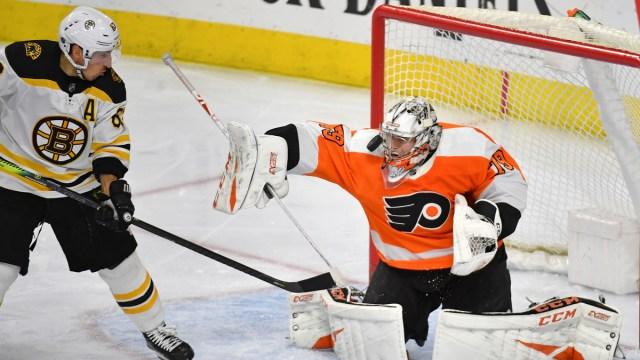 Boston Bruins Forward Brad Marchand And Philadelphia Flyers Goalie Carter Hart