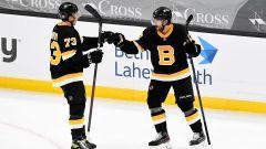Boston Bruins defenseman Charlie McAvoy, right winger Craig Smith