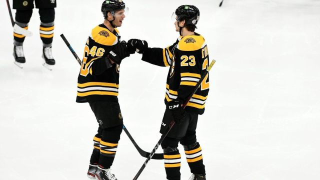Boston Bruins centers David Krejci, Jack Studnicka