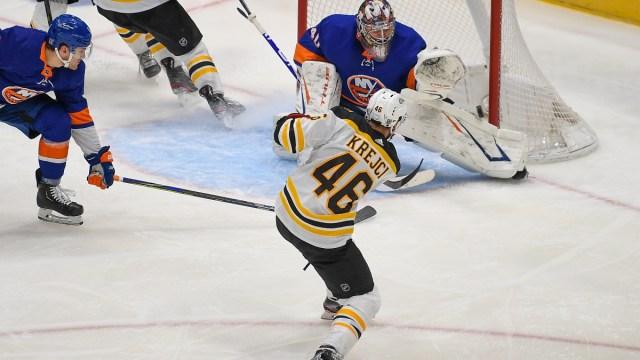 Boston Bruins center David Krejci (46) and New York Islanders goaltender Semyon Varlamov (40)