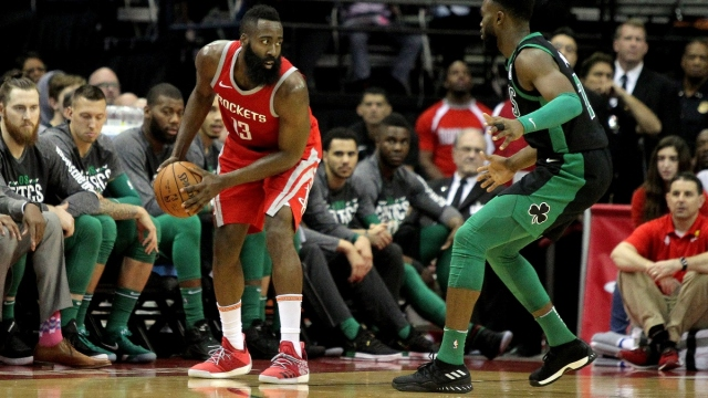 Brooklyn Nets guard James Harden (13) and Boston Celtics forward Jaylen Brown (7)