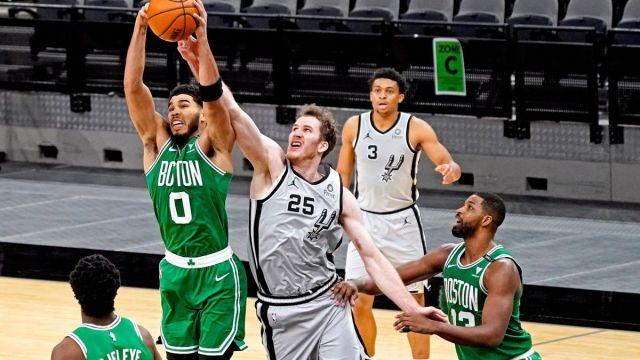 Boston Celtics forward Jayson Tatum, San Antonio Spurs center Jakob Poeltl