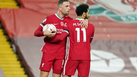 Liverpool midfielder Jordan Henderson (left) and forward Mohamed Salah