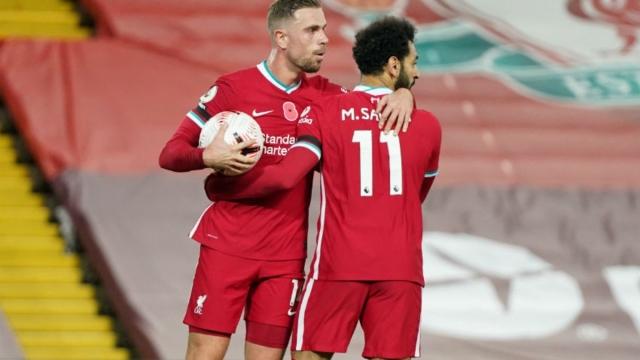 Liverpool midfielder Jordan Henderson (left) and forward Mohamed Salah