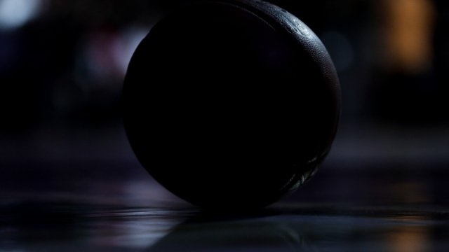A detail of a NBA Basketball in shadows