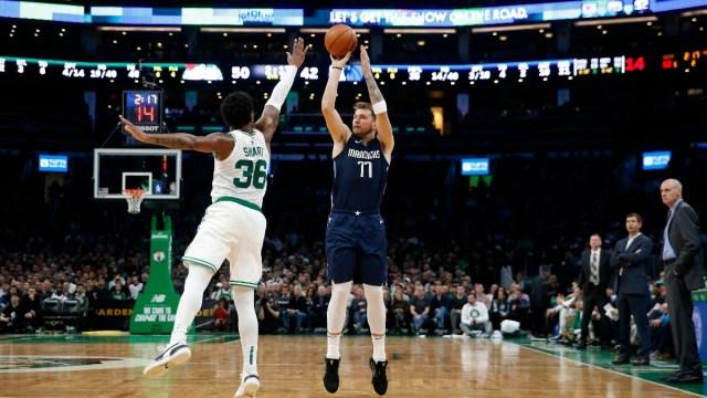Dallas Mavericks guard Luka Doncic (77) and Boston Celtics guard Marcus Smart (36)