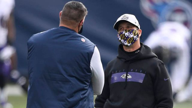 Tennessee Titans head coach Mike Vrabel and Baltimore Ravens head coach John Harbaugh
