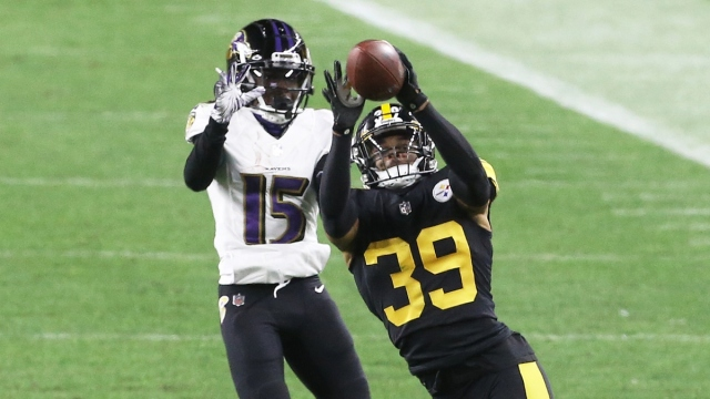 Pittsburgh Steelers free safety Minkah Fitzpatrick (39) and Baltimore Ravens wide receiver Marquise Brown (15)
