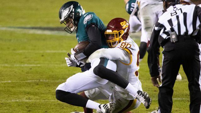 Philadelphia Eagles quarterback Nate Sudfeld and Washington Football Team defensive lineman Montez Sweat
