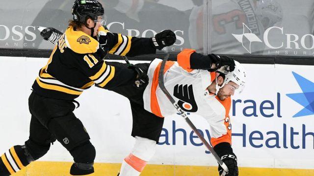 Boston Bruins forward Trent Frederic, Philadelphia Flyers defenseman Mark Friedman