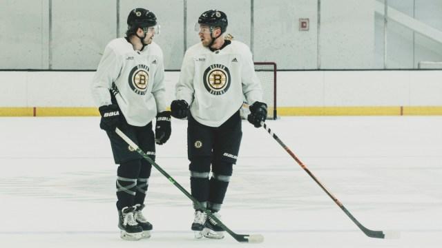 Boston Bruins wingers Jake DeBrusk, Ondrej Kase