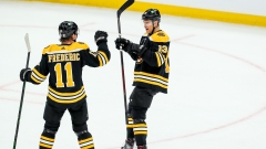 Boston Bruins center Charlie Coyle, forward Trent Frederic