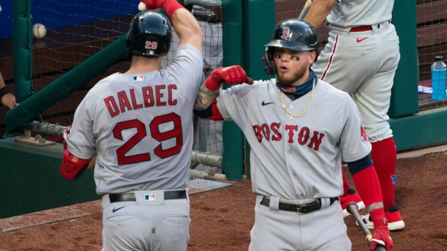 Boston Red Sox third baseman Bobby Dalbec (29) and outfielder Alex Verdugo (99)