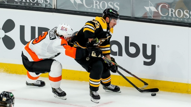 Philadelphia Flyers defenseman Ivan Provorov (9) and Boston Bruins left wing Brad Marchand (63)