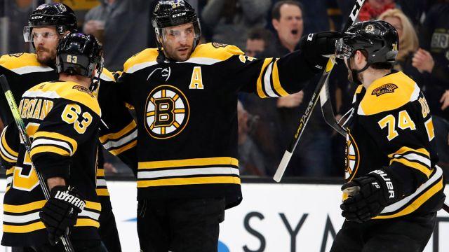 Boston Bruins forwards Brad Marchand, Patrice Bergeron, Jake DeBrusk