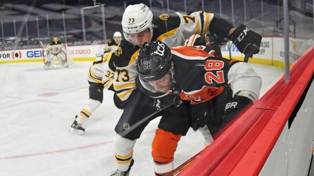 Boston Bruins defenseman Charlie McAvoy, Philadelphia Flyers winger Claude Giroux