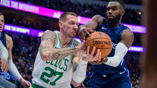 Dallas Mavericks guard Tim Hardaway Jr. and Boston Celtics center Daniel Theis