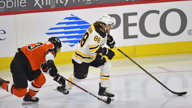 Boston Bruins right wing David Pastrnak (88) and Philadelphia Flyers defenseman Shayne Gostisbehere (53)