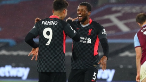 Liverpool forward Roberto Firmino (left) and Georginio Wijnaldum