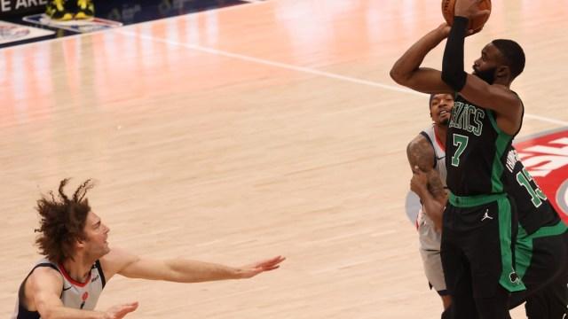 Boston Celtics guard Jaylen Brown (7) and Washington Wizards center Robin Lopez (15)