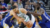 Boston Celtics forward Jayson Tatum (0), Golden State Warriors guard Stephen Curry (30) and forward Draymond Green (23)