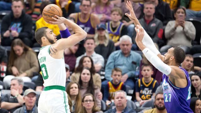 Boston Celtics forward Jayson Tatum and Utah Jazz center Rudy Gobert