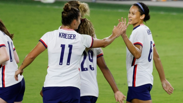 United States forward Lynn Williams (6) and defender Ali Krieger (11)
