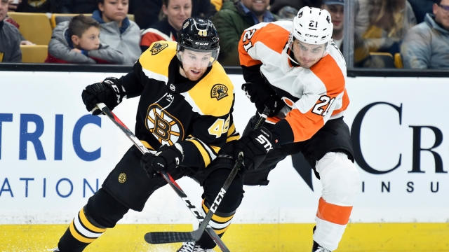Boston Bruins defenseman Matt Grzelcyk, Philadelphia FLyers forward Scott Laughton