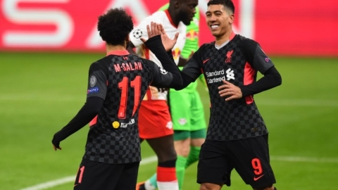 Liverpool forwards Mohamed Salah (left) and Roberto Firmino