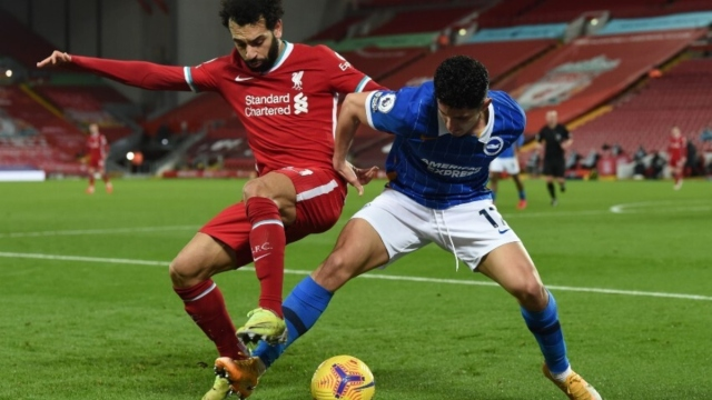 Liverpool forward Mohamed Salah (left) and Brighton midfielder Steven Alzate