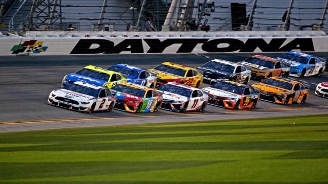 Brad Keselowski leads the field during the Daytona 500 at Daytona International Speedway.