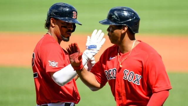Boston Red Sox shortstop Xander Bogaerts (2) and third baseman Rafael Devers (11)