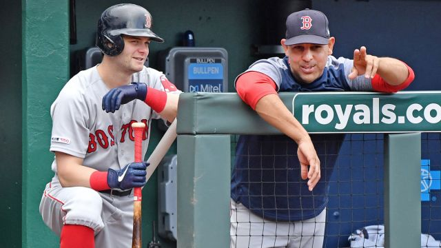 Kansas City Royals outfielder Andrew Benintendi, Boston Red Sox manager Alex Cora