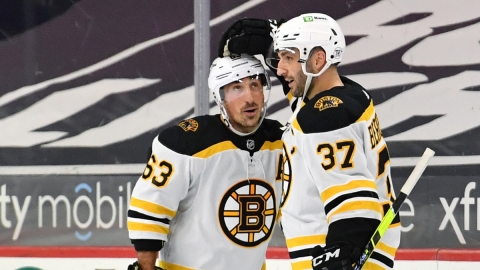 Boston Bruins forwards Brad Marchand and Patrice Bergeron