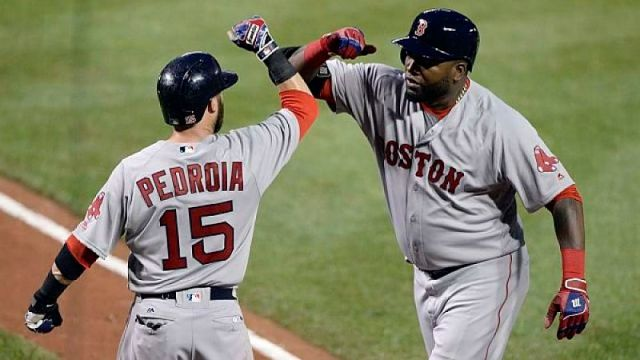 Former Boston Red Sox players David Ortiz and Dustin Pedroia